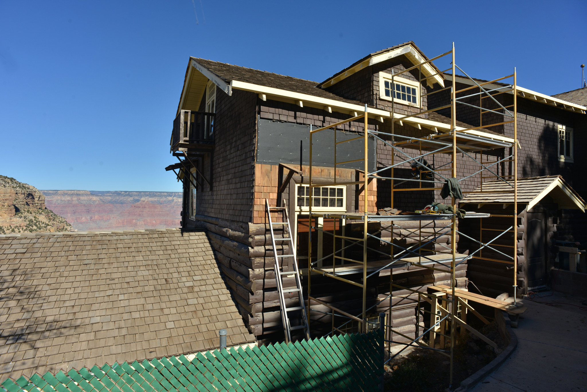 A home with a blue sky and open space backdrop currently under construction